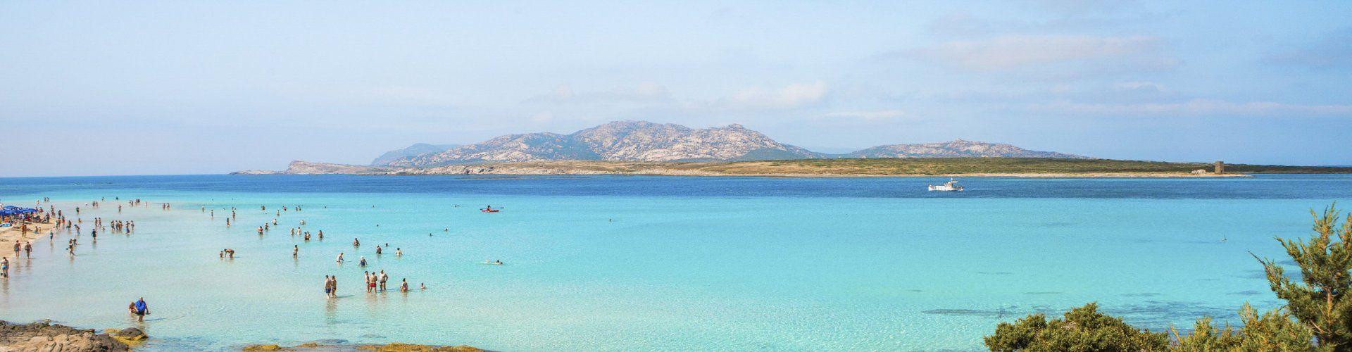 Crystal clear sea in front of the beach La Pelosa Stintino