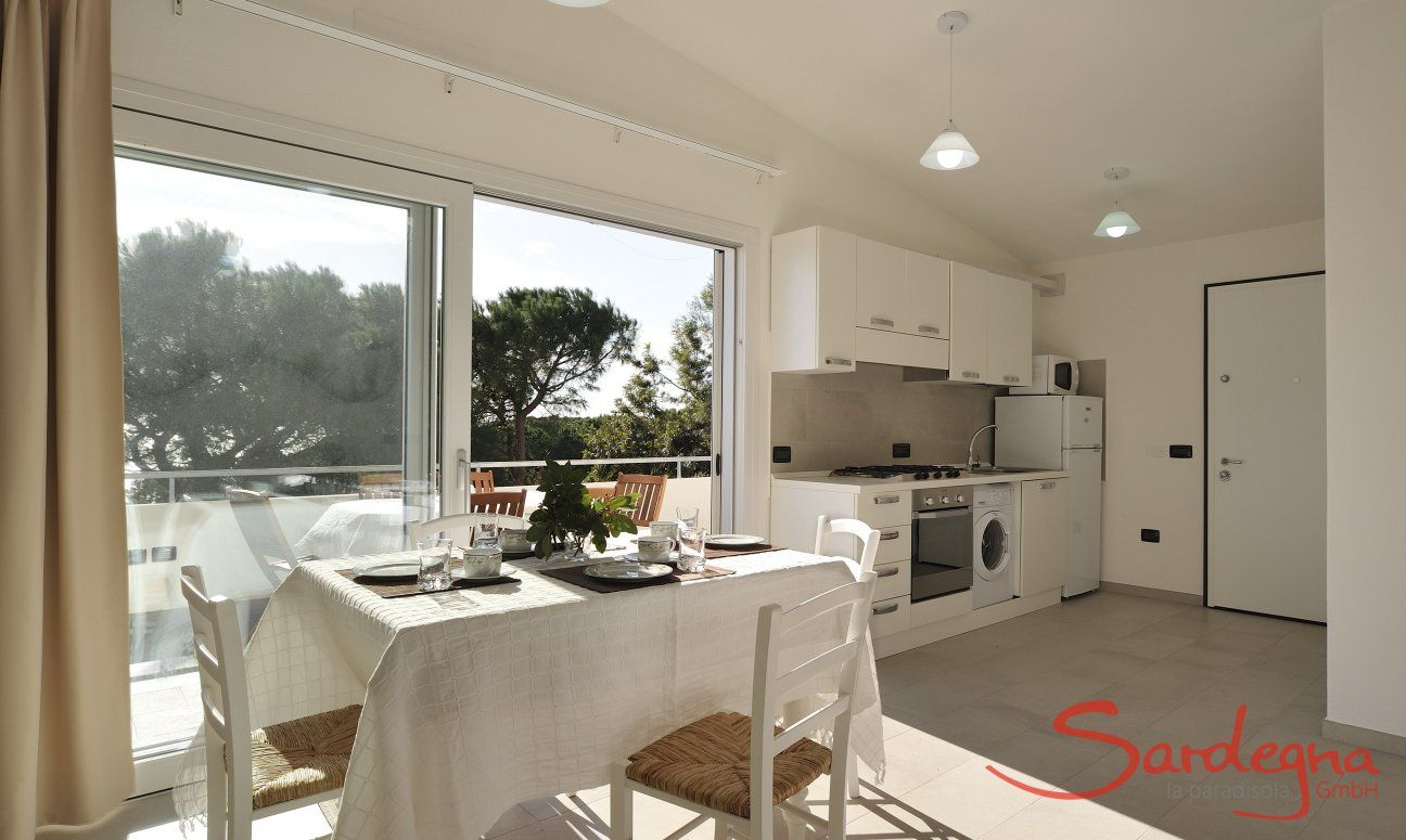 Dining area inside with open kitchen