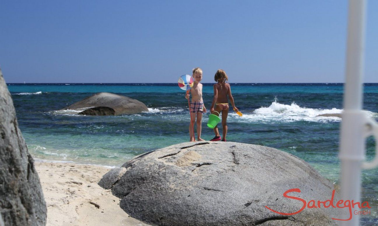 Children on the rocks in the sea of Sant Elmo