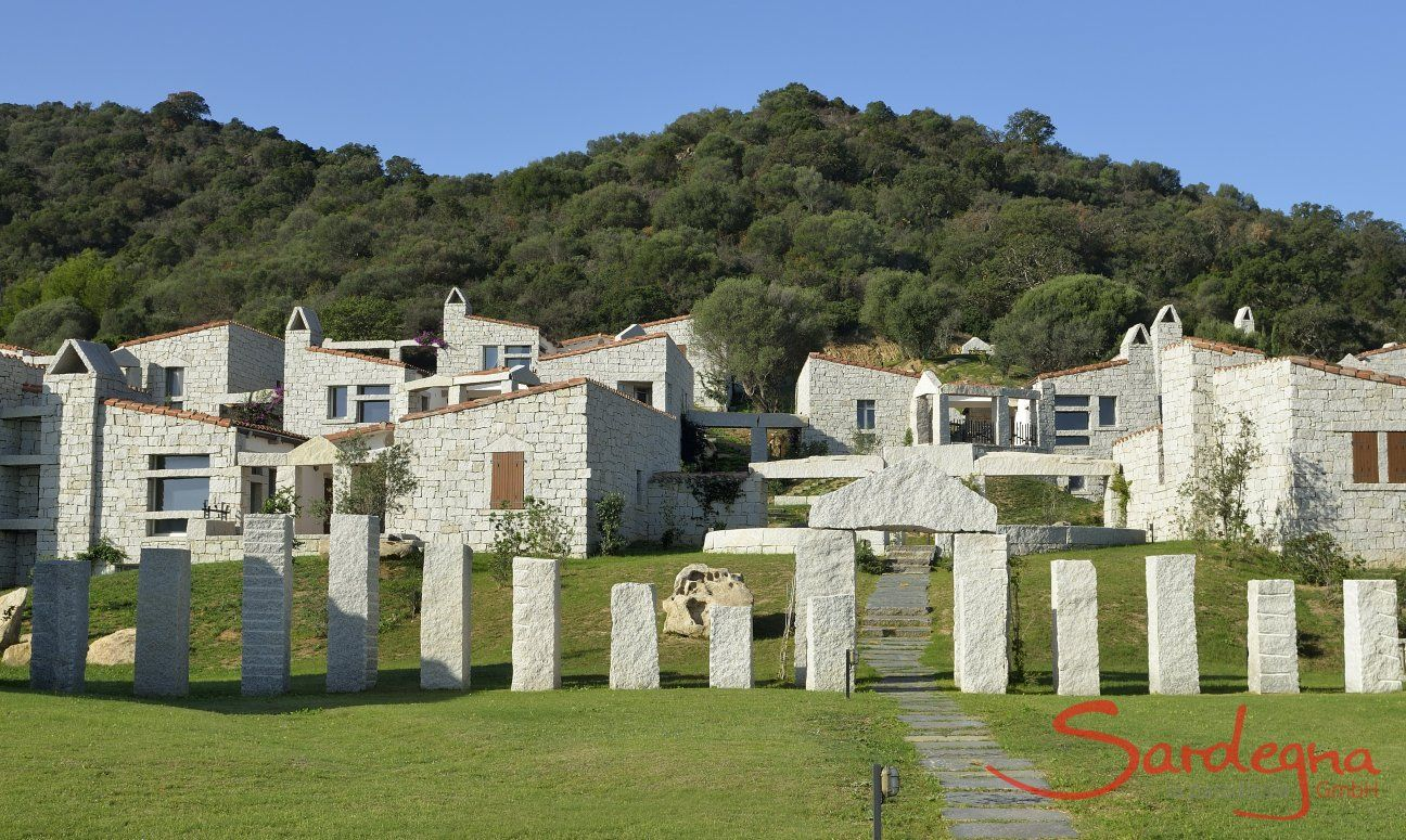 Holiday houses made out of grey granite rock form the complex Li Conchi