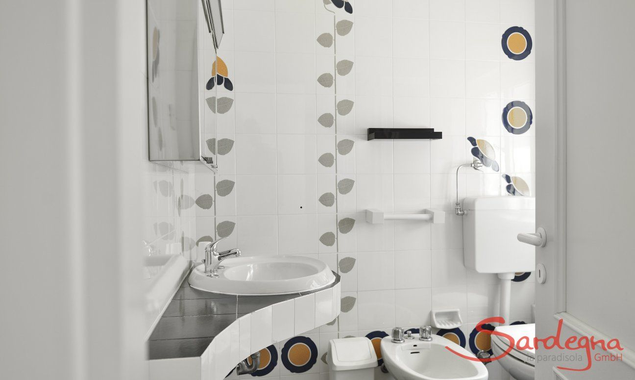 White tiled bathroom with shower