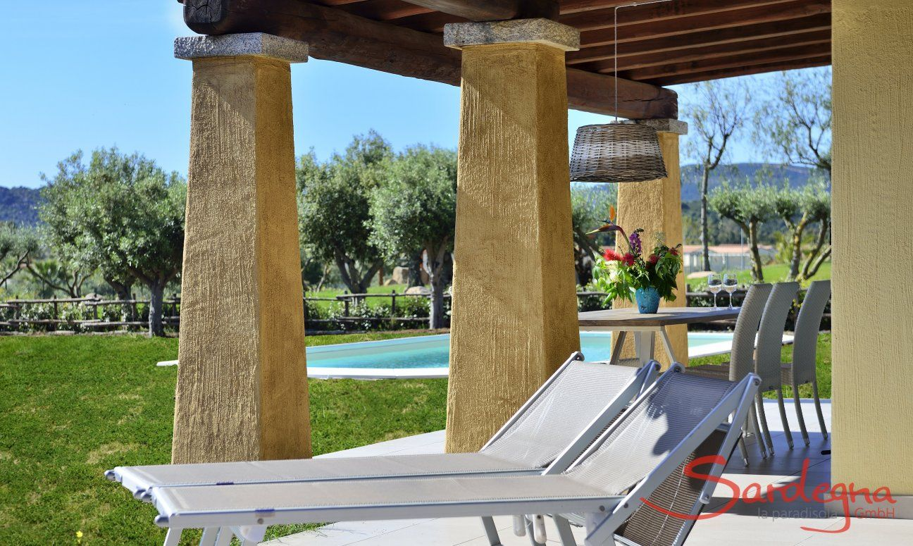 Sunbeds on the roofed terrace of  Villa Campidano 20