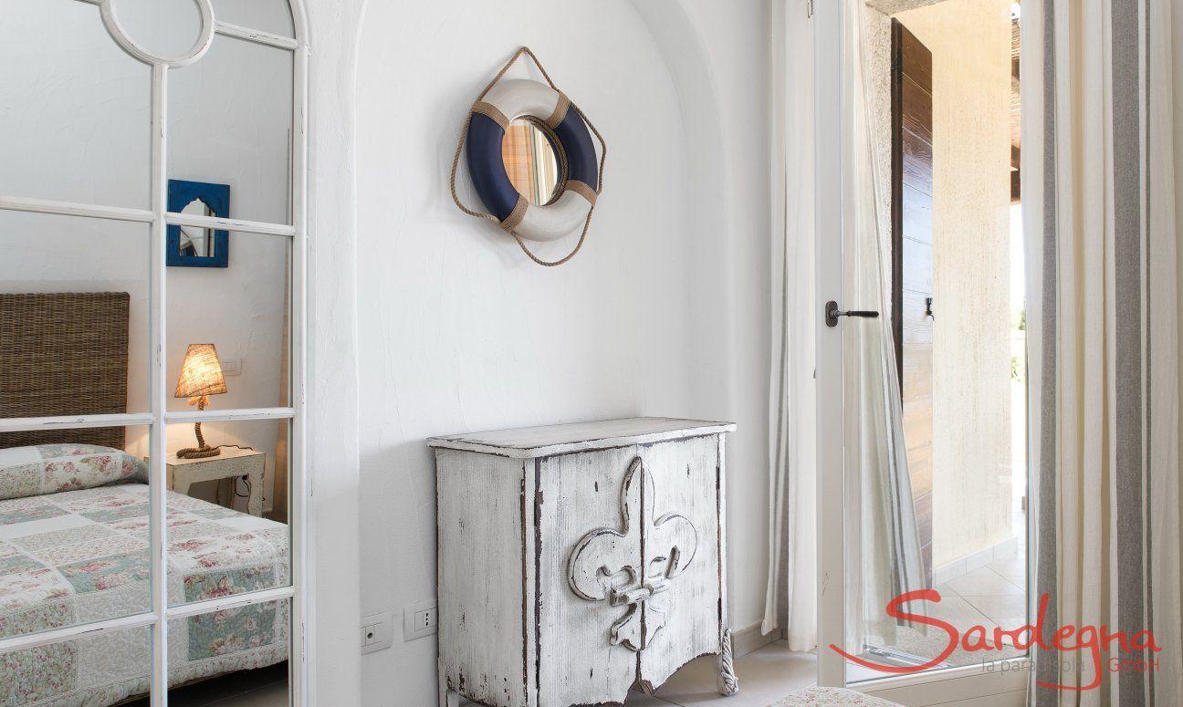 Bedroom with big mirror and dresser  Villa Campidano 21