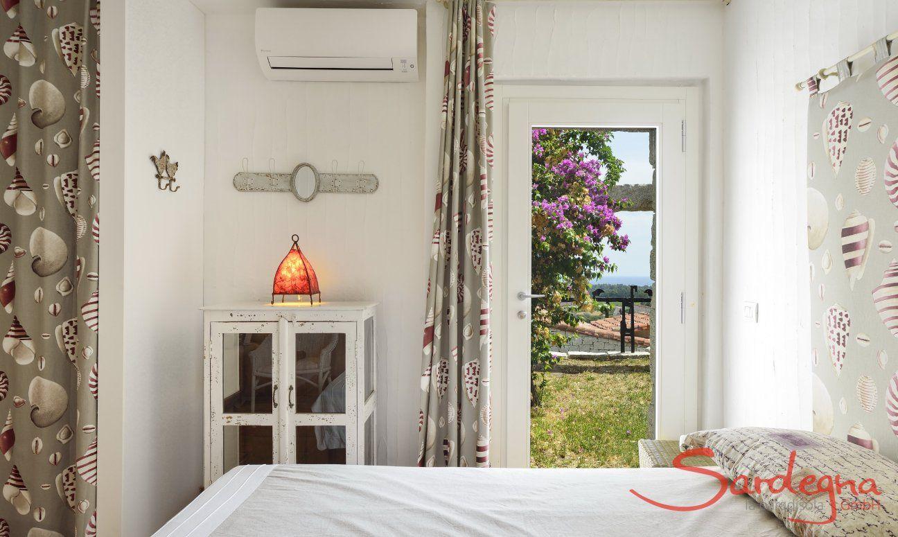 Bedroom with door to the garden