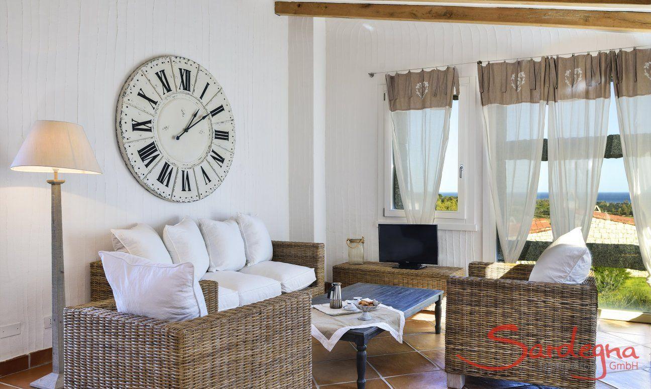 Sofa corner with big clock and panoramic window Li Conchi 9, Cala Sinzias
