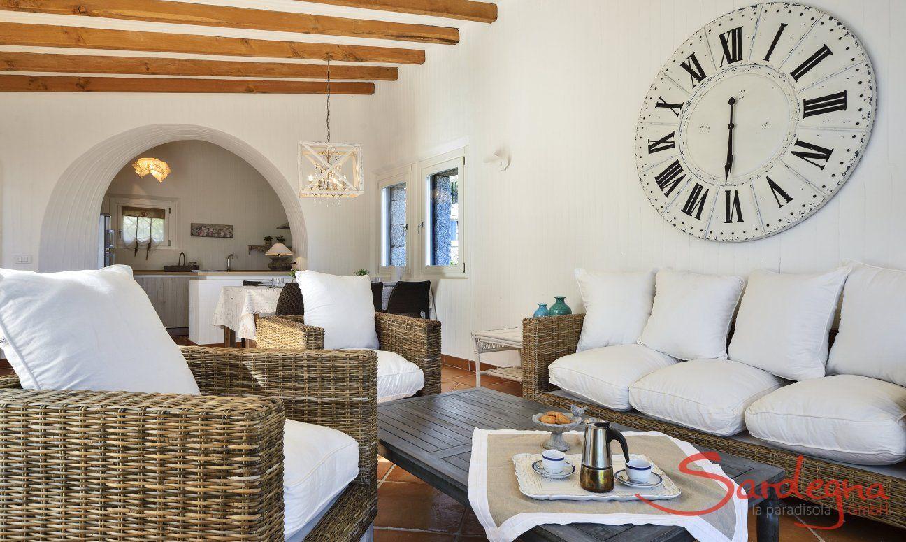 Sofa Corner and a big watch on the wall Li Conchi 10, Cala Sinzias