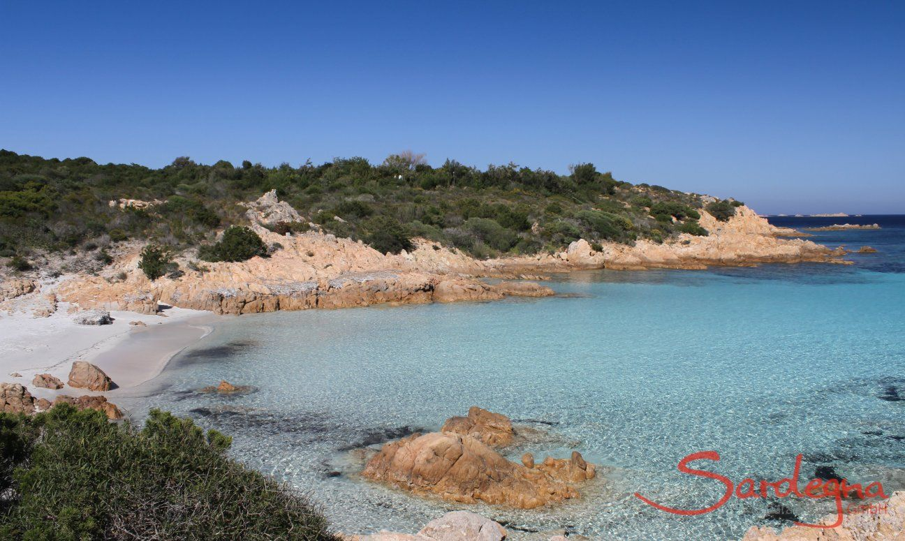 Crystal clear water over the white sandy sea bed of the beach Romazzino