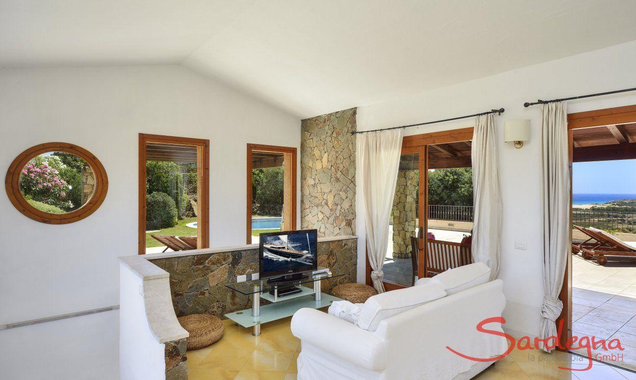 Sofa corner with a tv and big windows