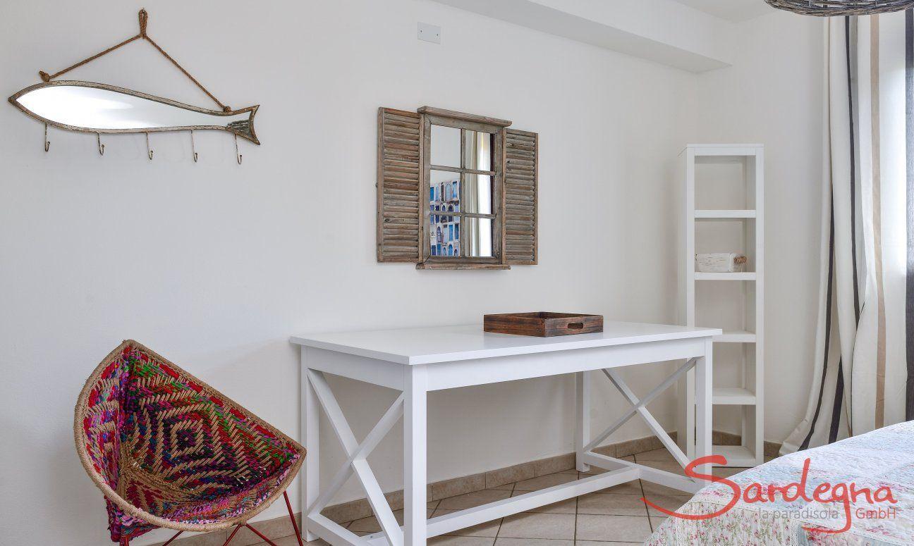 A writing desk in bedroom 1
