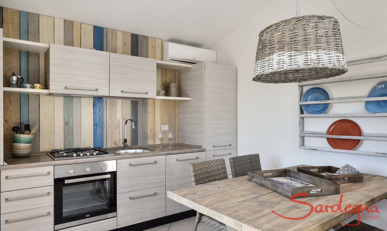 Modern and fully equipped kitchen and dining table