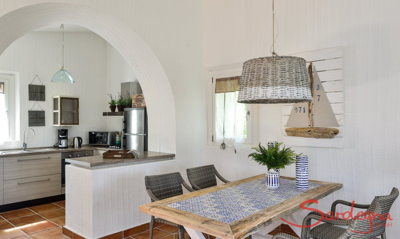 Dining table with kitchen in the background
