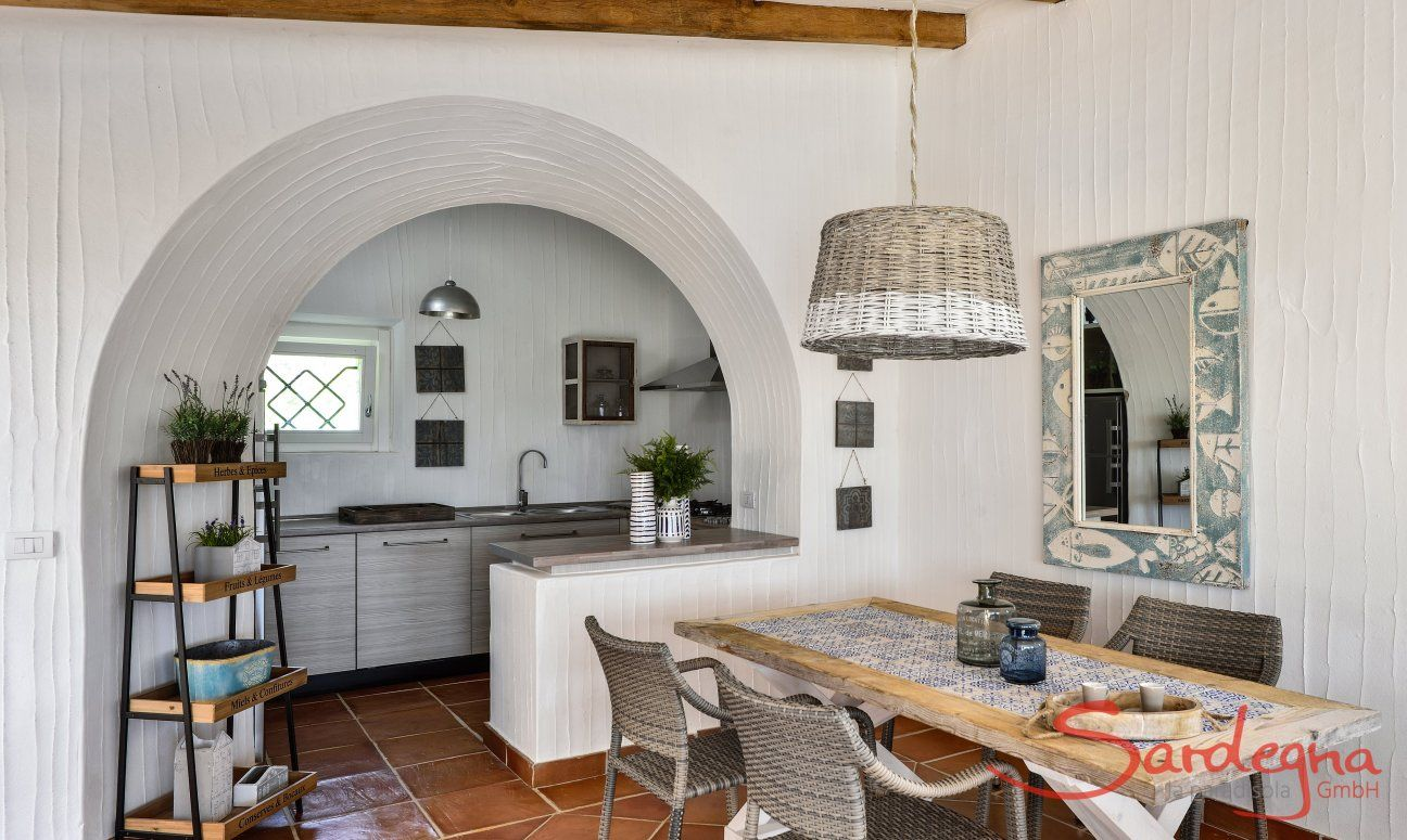 Dining area with kitchen in the background