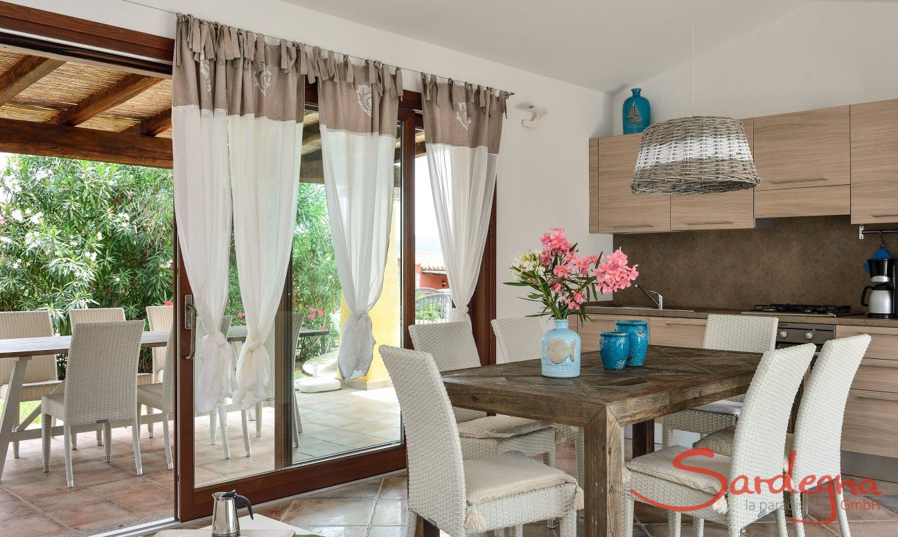 Bright dining room with kitchen