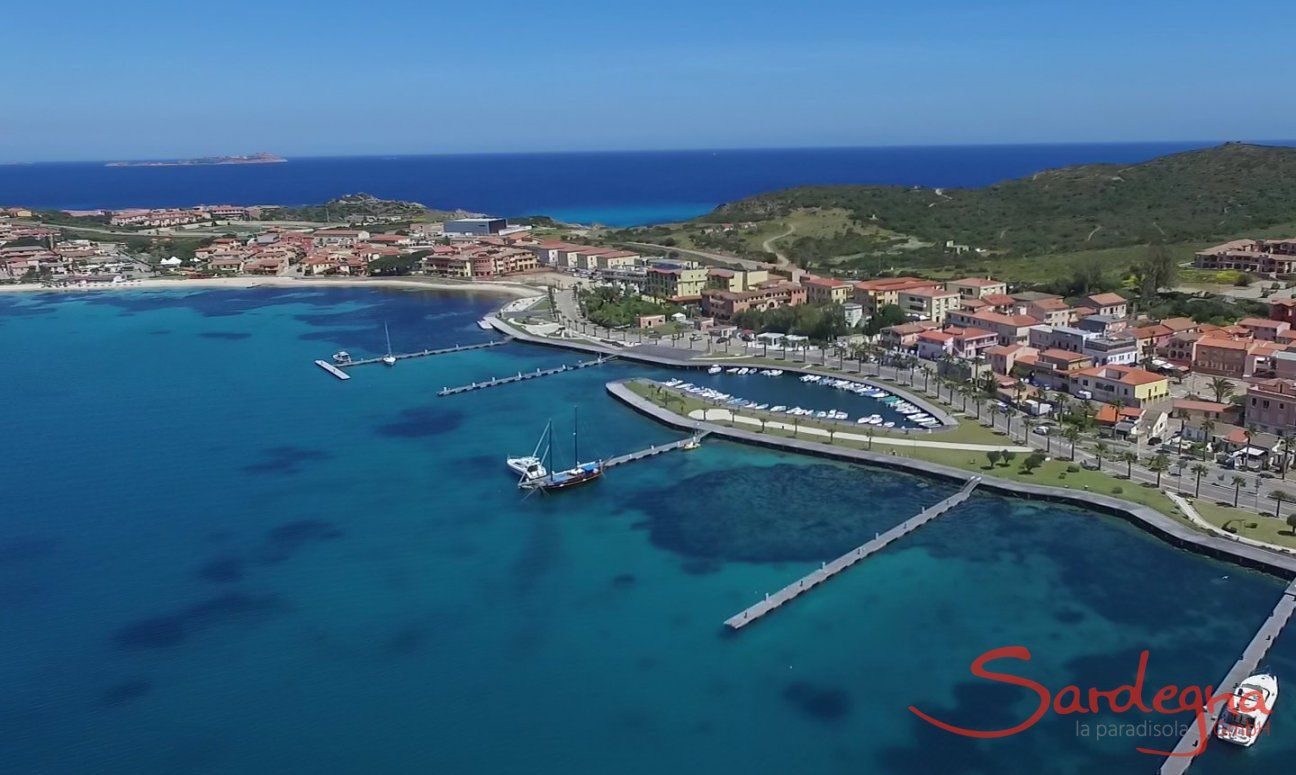 Airview of Golfo Aranci with boadwalk along the harbour an white beach
