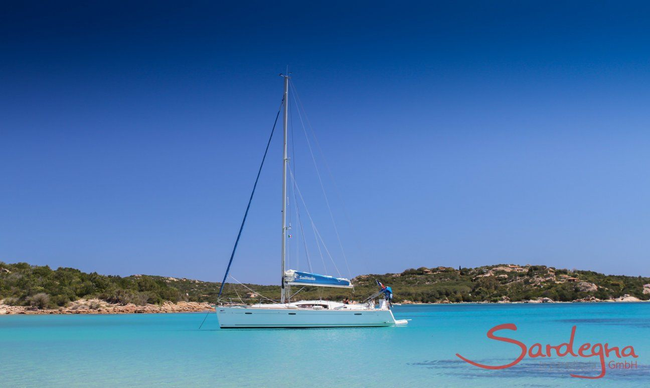 Sailing boat floating on the crystal clear water of Cala di Volpe