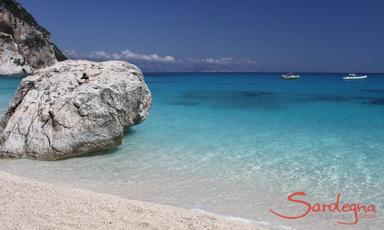 Big, white round rock in the crystal clear water in front of the beach of Cala Goloritze