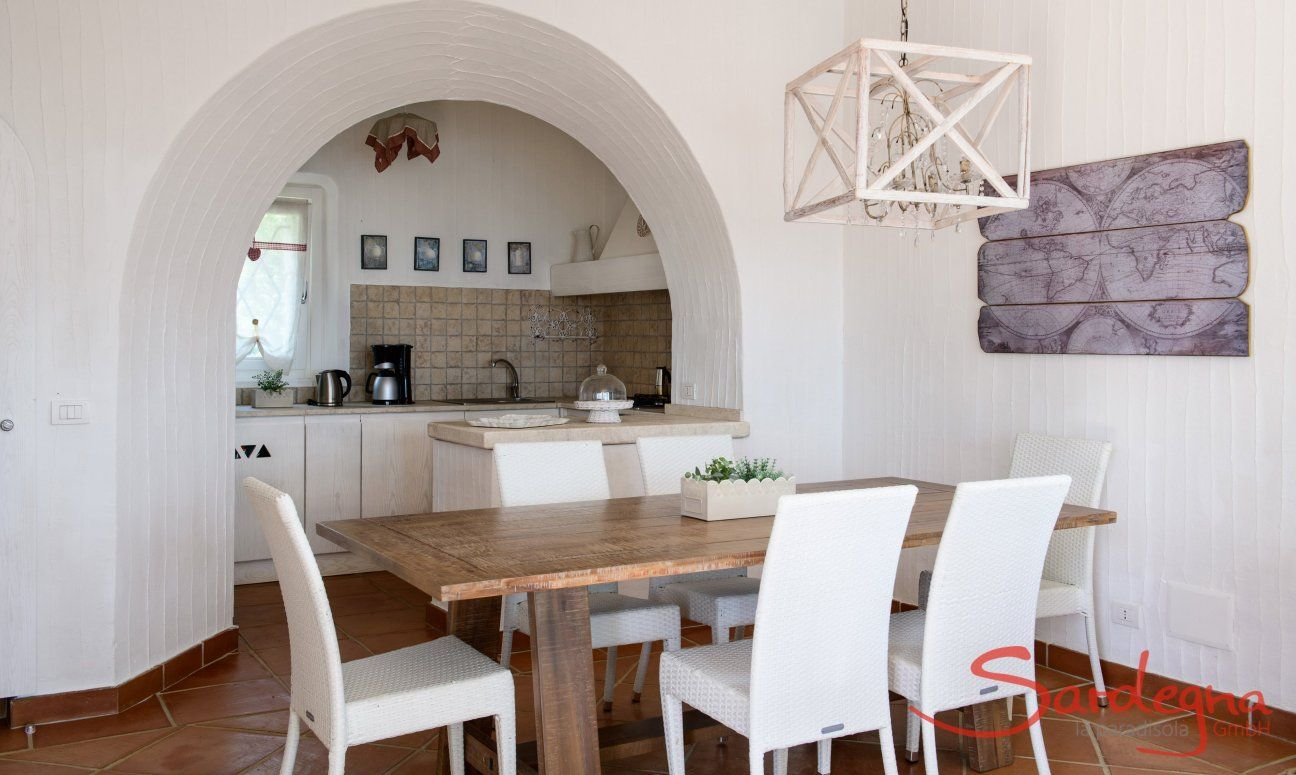 Dining area inside with a kitchen view