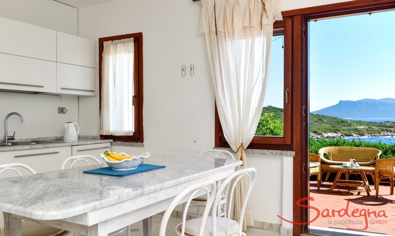 Dining table inside with sea view