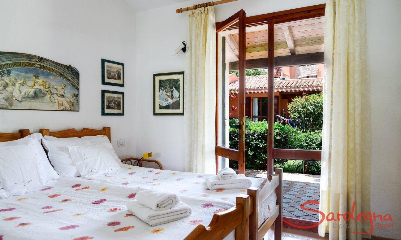 Bedroom 1 with garden door and single beds