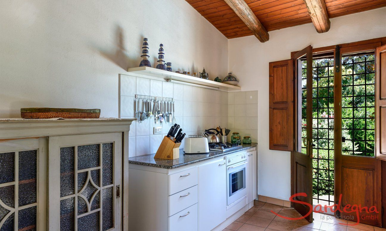 Fully equipped kitchen with garden access