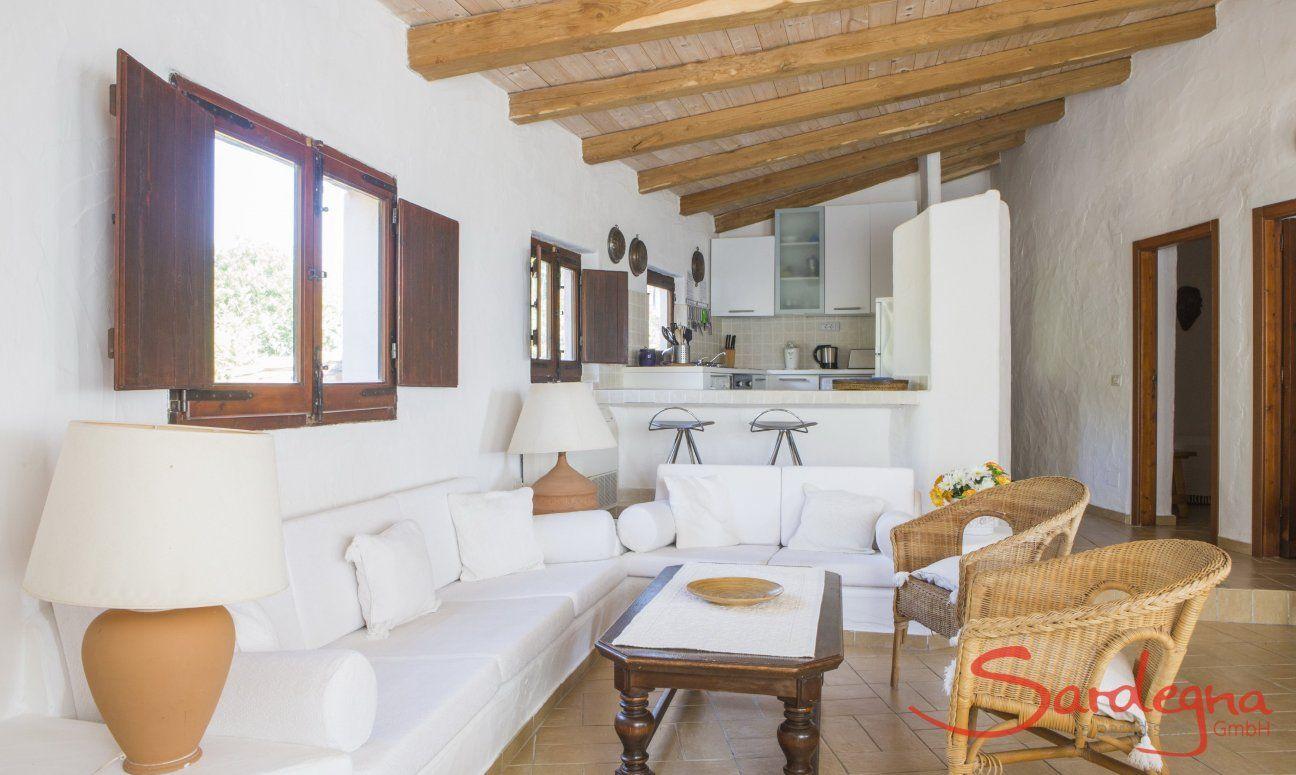 Sofa corner and kitchen of  Villa Fiori 2 in Is Molas