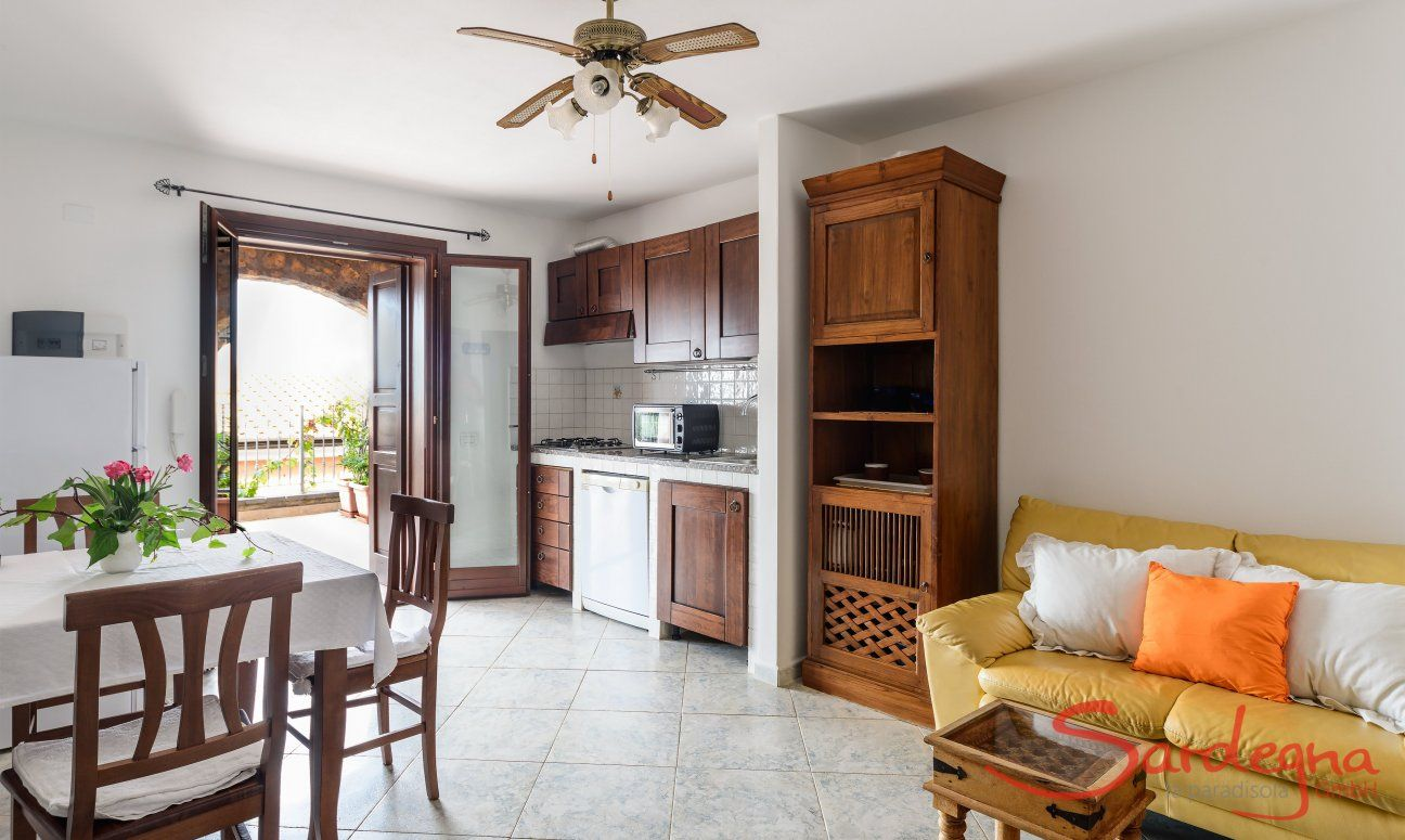 Living area with kitchen, dining table and kitchen