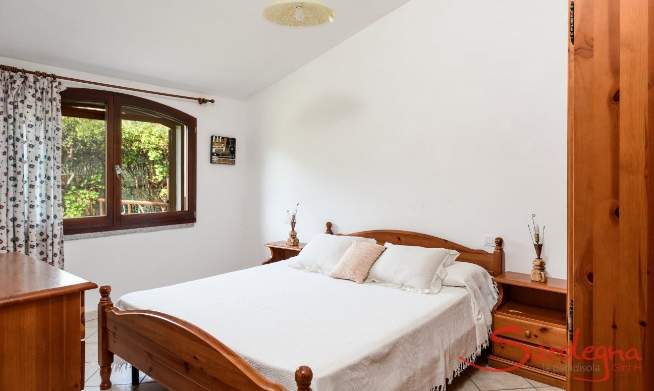 Bedroom 2 upstairs with one double bed and window with garden view