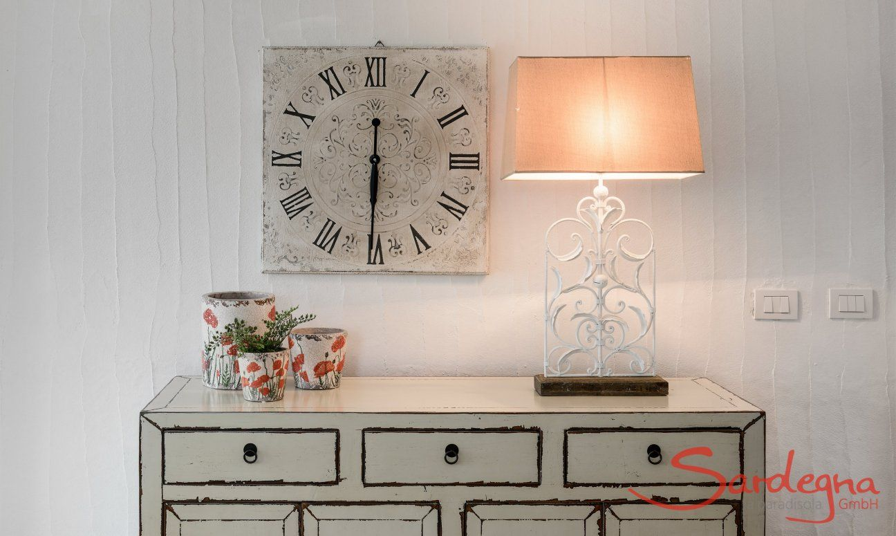 Chest of drawers shabby with clock and lamp