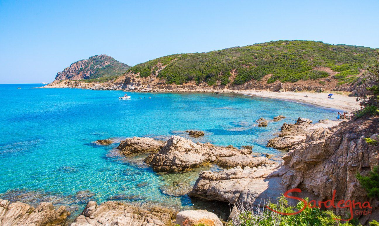 Crystal clear water bathes the rocks of Capo Ferrato