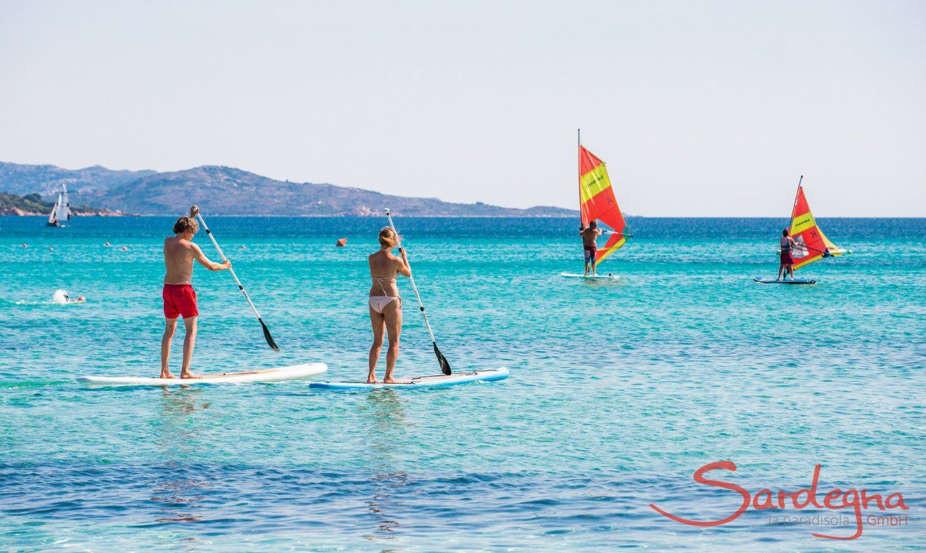 Stand-up paddle and Windsurf in the bay of La Cinta, San Teodoro, Olbia
