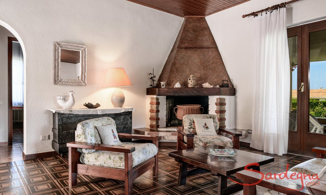 Living room with big fire place, Villa Palme, Costa Rei