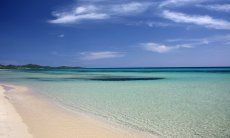 Crystal clear water on the beach of Costa Rei