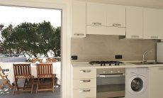 Bright kitchen with direct terrace access