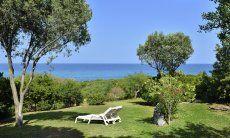 View across the wide garden towards the blue sea