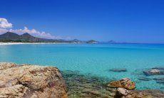 Dreamlike clean water at the beach of Cala Sinzias