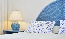 Double bed with night table and lamp in light blue