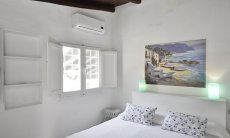 Bedroom with double bed , window and airconditioning