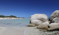 Sant Elmo beach with crystal clear water and granite rocks