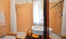 Bath in orange with shower in  Villa Serena, Costa Rei