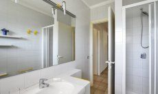 2nd Bathroom ground floor with a shower and a big mirror