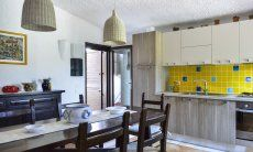 Fully equipped kitchen with dining table and garden access