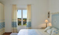 Main Bedroom with gardenview Li Conchi 10, Cala Sinzias