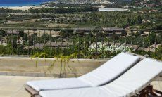 View from the sunbeds of Torretta Chia over the landscape all the way to the beach of Chia