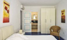 Bedroom 4 with double sized bed and ensuite-bathroom