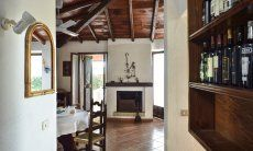 Living room with dining table and a sardinian chimney