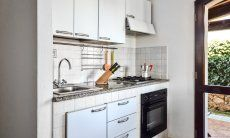 Fully equipped kitchen upstairs with oven, gas stove and big fridge with freezer