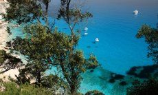 View from above through the trees on the crystal clear sea of Cala Goloritze
