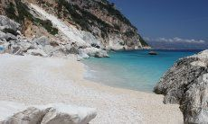 White, limestone beach of Cala Goloritze with view on the sea and the steep cliffs of the coast