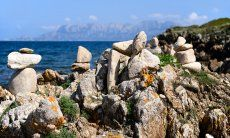 Rocks and the isle of Tavolara in the background