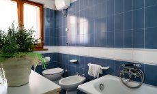 Modern and bright bathroom with bathtube and bidet